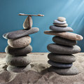 Equilibrium tower stones blue background Royalty Free Stock Images