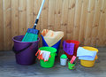 Equipment for cleaning in the house bright colorful buckets on a wooden background Royalty Free Stock Images