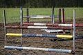 Equitation obstacles and barriers on a training track in row horse jumping rural scene Stock Image