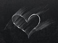 Erased heart on chalkboard Royalty Free Stock Photos