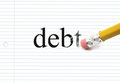Erasing debt on notebook paper the word written with the end of a pencil the black letters showing eraser marks making a great Stock Photography