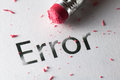 Erasing error removing word with pencil s eraser Stock Image