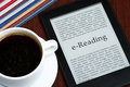 Ereader ereading ebook reader and a cup of coffee Stock Image