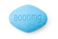 Erectile dysfunction pill closeup of a single generic blue isolated on a white background Stock Image