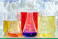 Erlenmeyer flasks with chemical solutions conical glass filled colourful in a scientific laboratory conducting experiments tests Stock Image