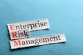 Erm abbreviation acronym enterprise risk management on blue paper Stock Photos