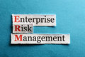 Erm abbreviation acronym enterprise risk management on blue paper Royalty Free Stock Photo