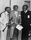 Ernie banks hall of fame major league baseball player is joined by an elderly jazz musician and a high school official at an inter Stock Image