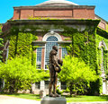 Ernie davis statue at syracuse university of first african american to win the heisman trophy next to hendricks chapel in Royalty Free Stock Photo