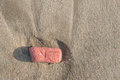 Eroded cobblestone on the beach sand Royalty Free Stock Photo