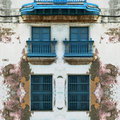 Eroded Old Havana facade with blue windows Royalty Free Stock Photo