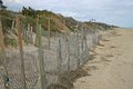 Erosion control fences protect houses along the beach Stock Images