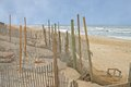 Erosion control fences protect houses along the beach Stock Image