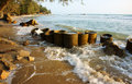 Erosion, wave destroy seawall, effect of climate change Royalty Free Stock Image