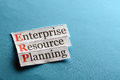 Erp abbreviation enterprise resource planning on blue paper Stock Images