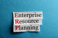 Erp abbreviation enterprise resource planning on blue paper Royalty Free Stock Photos