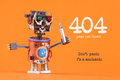 404 error page not found concept. Don`t panic I`m a mechanic. Robotic handyman with screw driver. macro view, orange