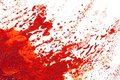 Eruption or explosion in red paint. Stock Photos