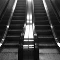 Escalator black and white photo with selective focus Stock Images