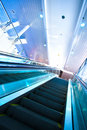 Escalator in blue corridor Stock Images
