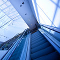 Escalator in blue corridor Royalty Free Stock Images