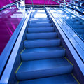 Escalator in blue corridor Royalty Free Stock Photos