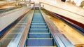 Escalator inside modern business commercial building Stock Photo