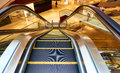 Escalator inside modern commercial building Royalty Free Stock Image