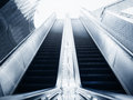 Escalator in office building Blue toned images Royalty Free Stock Photo