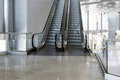 Escalator room with glass Royalty Free Stock Photo