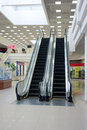 Escalator in shopping mall moving staircase Stock Photos