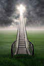 Escalator to the cross an on green field with cloudscape Royalty Free Stock Images