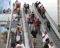Escalators with people going up and down the Royalty Free Stock Photography