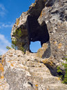 Escalera y agujero en roca Foto de archivo
