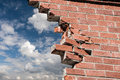 Escape broken brick wall and blue sky with clouds Stock Images