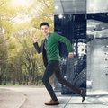 Escape from the modern office to the outdoor park asian young man concept of freedom balance work Royalty Free Stock Image