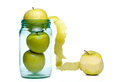 Escape from ordinary glass jar full of apples on a white background showing concept of usually and a single cleaned apple Stock Photos
