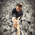 Escape from tax businessman clinging to rope Stock Photos