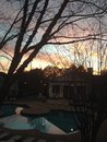 Escena anaranjada del cielo de la puesta del sol en invierno Imagen de archivo libre de regalías