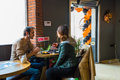 Eskisehir, Turkey - April 15, 2017: Couple sitting at cafe table.