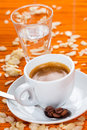 Espresso caffee almond flavor on orange background Royalty Free Stock Image