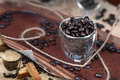 Espresso and coffee beans in an glass page curl revealing biscotti Stock Images