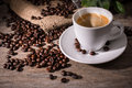 Espresso coffee cup of and beans on wooden background Stock Images