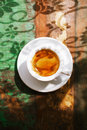 Espresso coffee cup on rustic table with sun light and shadows Stock Image