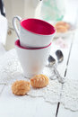 Espresso coffee cups italian mocha and small biscuits morning selective focus on biscuit toned photo Stock Photo