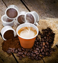Espresso coffee in disposable cup with pods on wooden table Stock Photography