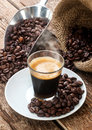 Espresso coffee in glass cup with coffee beans. Royalty Free Stock Photo