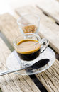 Espresso coffee in glass cup on wooden table Royalty Free Stock Photo