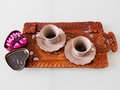 Espresso coffee with heart-shaped chocolates Royalty Free Stock Photo