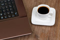 Espresso coffee with laptop Royalty Free Stock Images